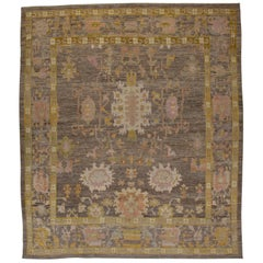 Contemporary Turkish Oushak Rug with a Brown Field and Gold Borders