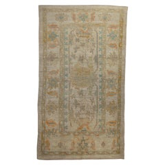 Contemporary Turkish Oushak Rug with Large Flower Head on Center Field