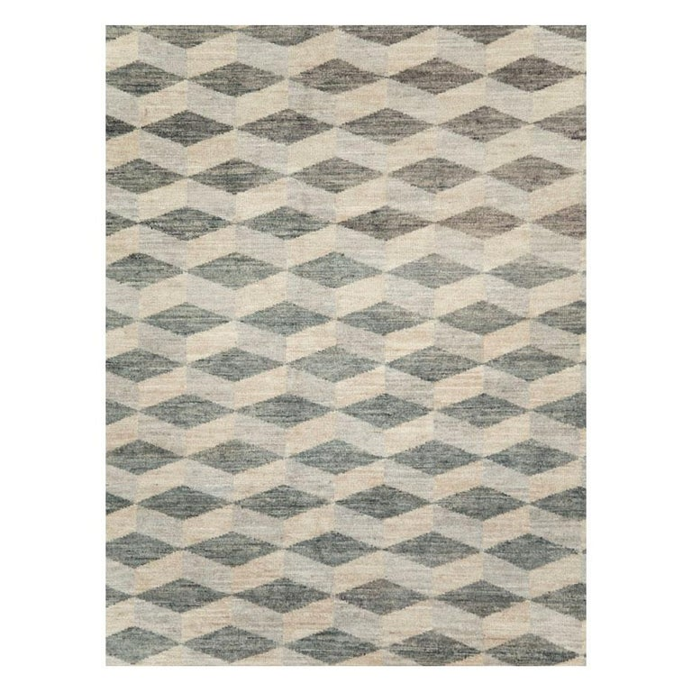 A modern Turkish room size carpet handmade during the 21st century with a diamond cube pattern in neutral tones.