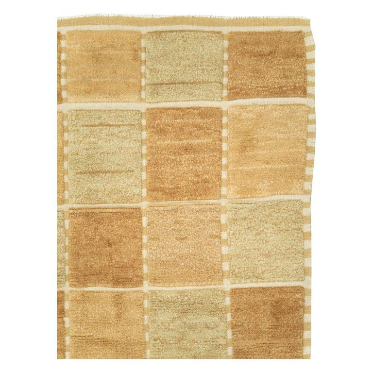 A modern Turkish square room size carpet handmade during the 21st century. The design and weave are inspired by vintage Swedish rugs from the mid-20th century period.  Measures: 9' 10