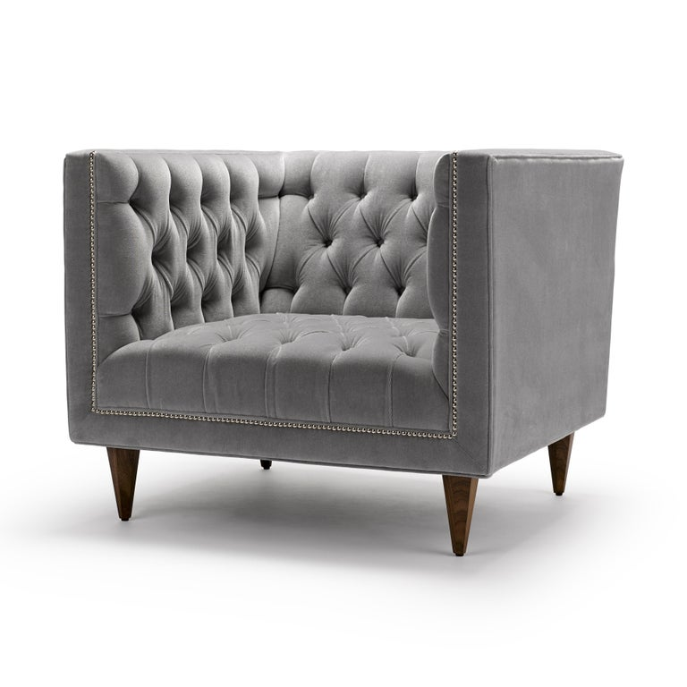 The Tux chair is our contemporary interpretation of the Classic Chesterfield. The deep buttoning and tailored detailing make this piece a personal favourite. Shown here upholstered in Altfield Aria mohair velvet, with legs in natural oiled walnut