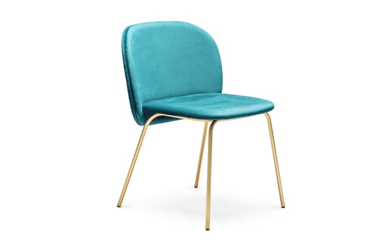 Sleek and stylish dining set of 8 chairs featuring ample curves and generous size with high functionality. Upholstered in arctic blue ultra suede fabric and satin brass base. Handcrafted in Italy Dimensions: Width 58 cm - 23 in Height 79 cm - 31