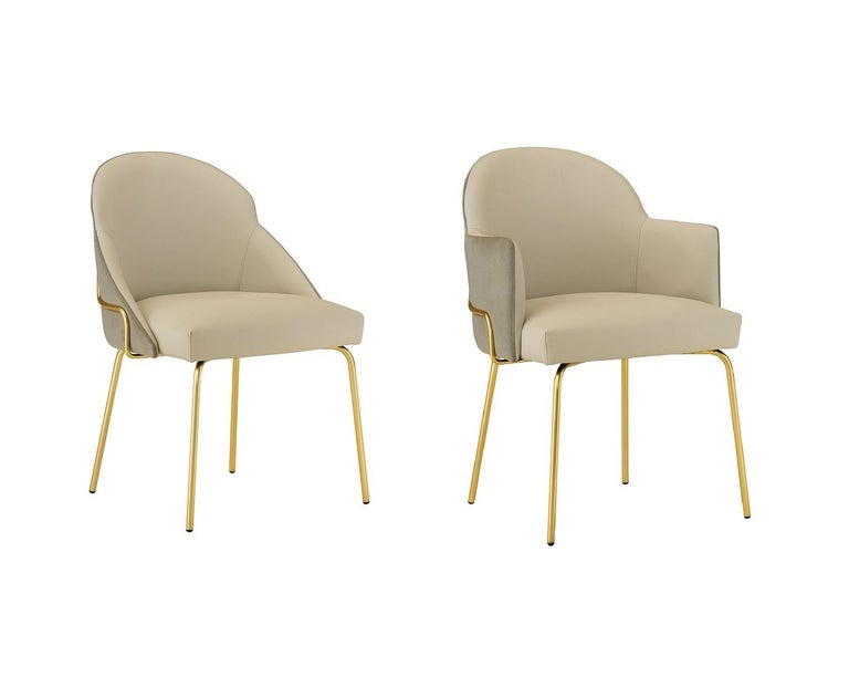 Upholstered seat and back in faux beige leather and taupe fabric. The chair is offered in a powder coated brass legs with floor protecting glides. Curved back for greater support and comfort. Handcrafted in Italy.
