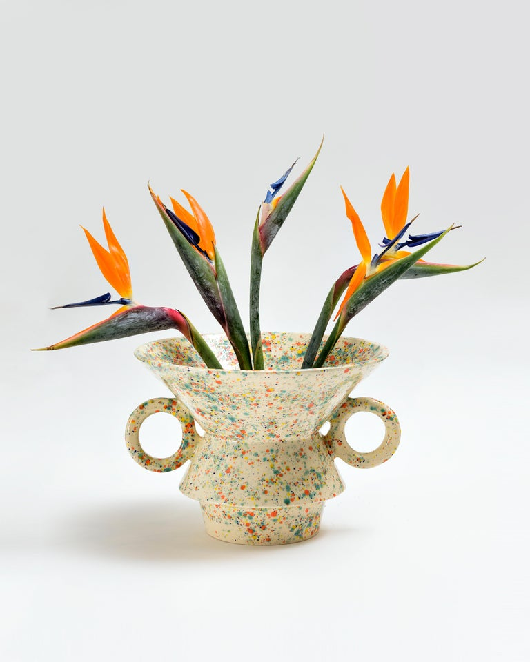 This contemporary vase is part of the Morphus collection, which is composed of six vases with different proportions, all of them executed by hand on a ceramic lathe. This technique uses a rotating disk where the clay is placed and together with the