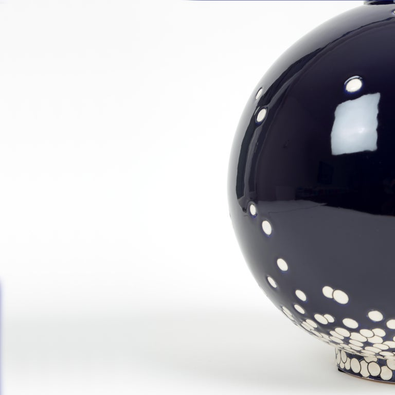 Superb round vase in limited edition with gently falling white snow against a midnight blue sky. The artist Eric Hibelot was commissioned by Les Emaux de Longwy to create a contemporary design for their world famous Boule vases. Inspired by the