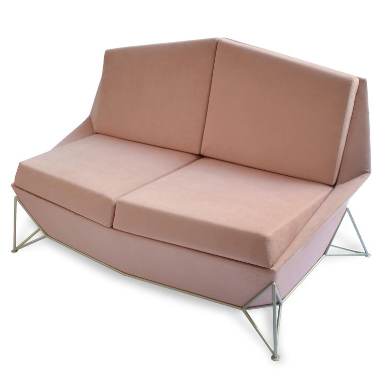 This contemporary styled sofa used a concept of triangulation what form for the structure of the feet, with this system the very weight of the sofa makes the structure fit and lock itself.  The rest of the contemporary sofa design, follows the same