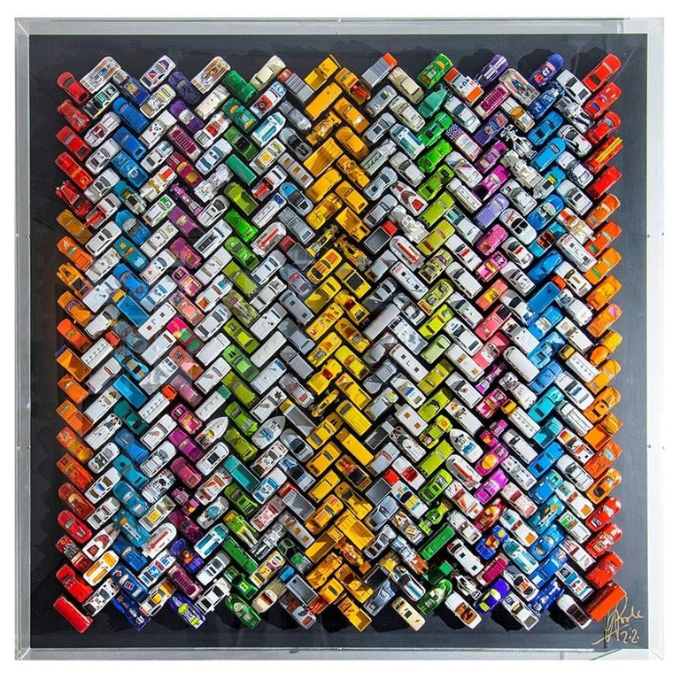 Unique piece. Titled 'Giant Ziggy-Zaggy Stripey Gridlock', Laurence Poole's clever colour composition expressed through precise arrangement of 400 vintage toy cars, is a joyful and captivating wall sculpture to brighten an interior and delight