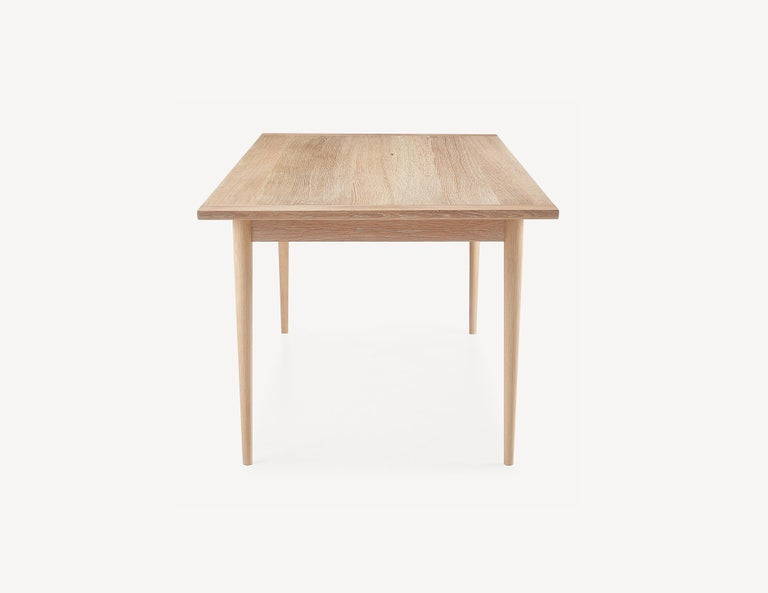 Carefully selected materials and refined proportions give the Lakeshore table an elegant, rational quality. Brass-pinned breadboard ends and quarter sawn white oak top are centuries-old craft techniques employed to keep this solid wood top stabile
