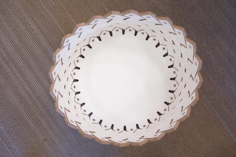 Contemporary white woven leather circular Almeria basket. Handmade in Italy.