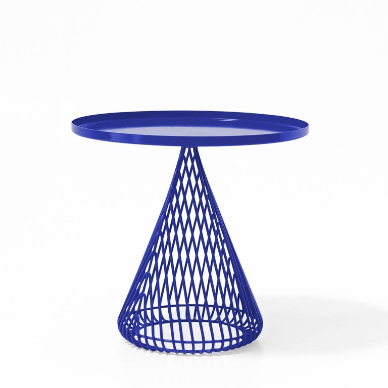 Use this streamlined accent table between two chairs in your living room to rest a cocktail or outside next to a pool lounger to place your sun tan lotion.  This piece is available in Black, White, Electric Blue, Peacock Blue  Please message us with