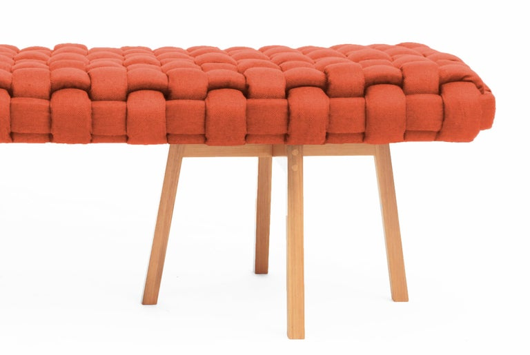 This bench is handmade in a contemporary design and produced with linen and Freijó wood.