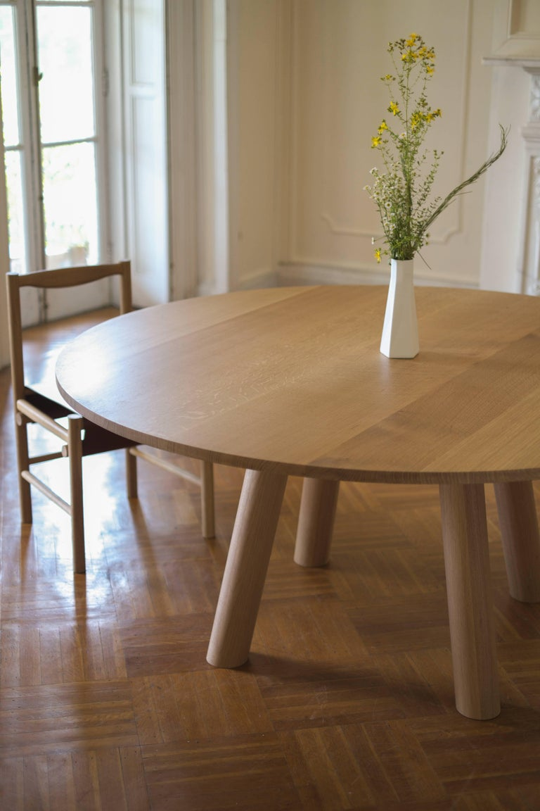 Contemporary Wood Round Column Dining Table In White Oak