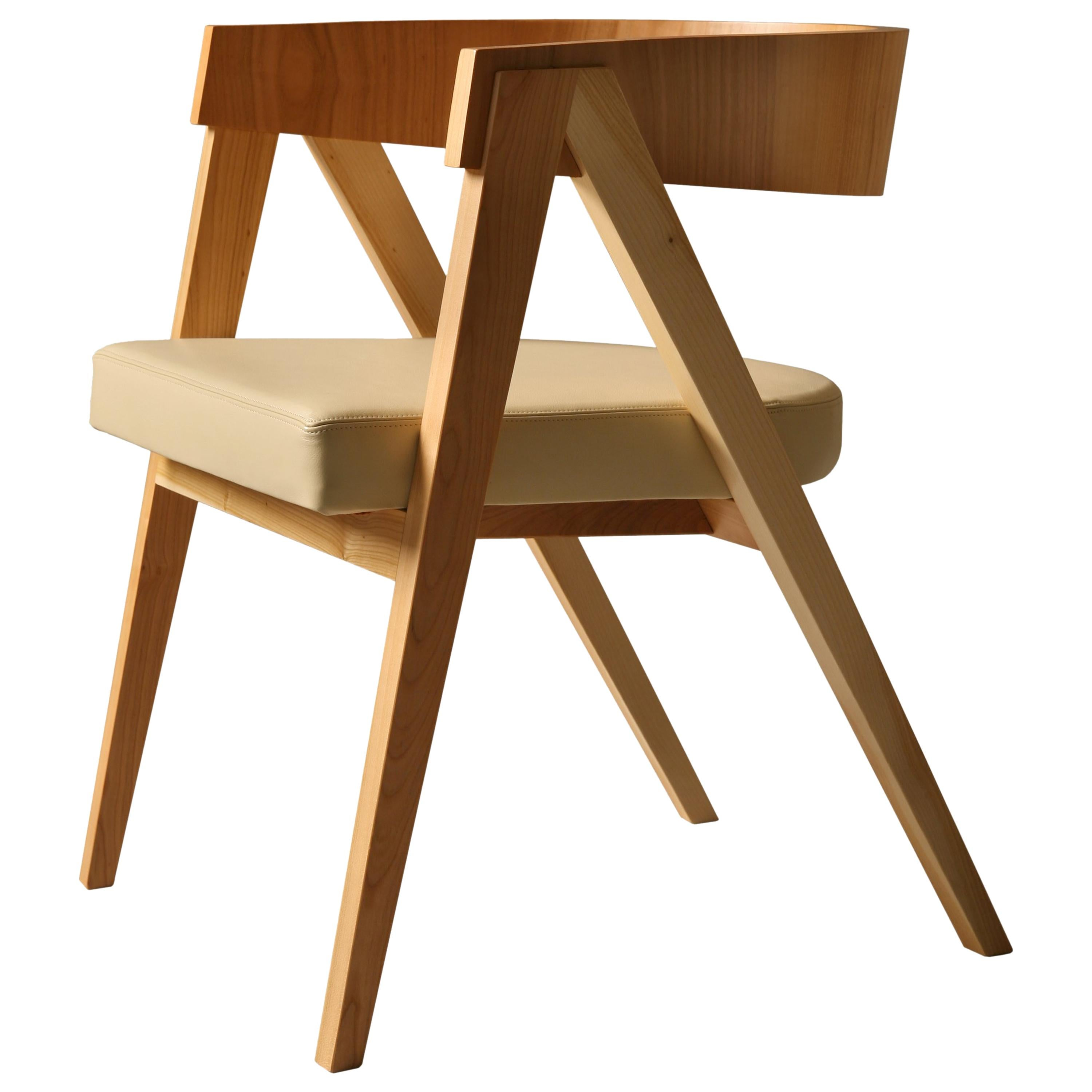 Contemporary Wooden Armchair Made of Maple with Padded Seat and Curved Backrest
