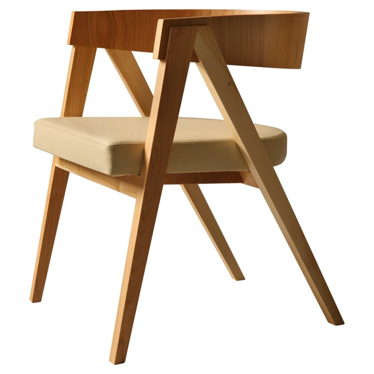 Contemporary Wooden Armchair with Padded Seat and Curved Backrest For Sale