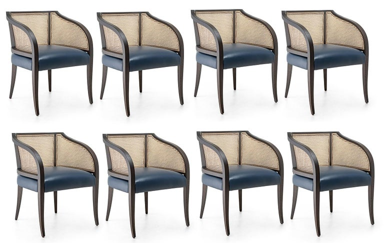 Built by hand from solid wood frame in dark ebony finish. Backrest in natural woven cane. Upholstered seat in black leather.  Dimensions: W 47 cm x D 61 cm x H 77 cm Materials: Wood, leather, rattan Seat H 46 cm Available in COM.