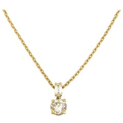 Contemporary Yellow Gold Round and Baguette Diamonds Pendant Necklace