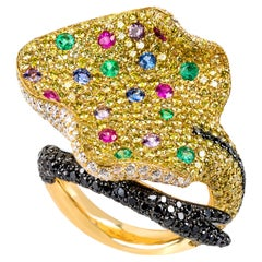 "Contemporary Yellow Gold ""Stingray"" Ring with Diamonds, Emeralds and Sapphires"