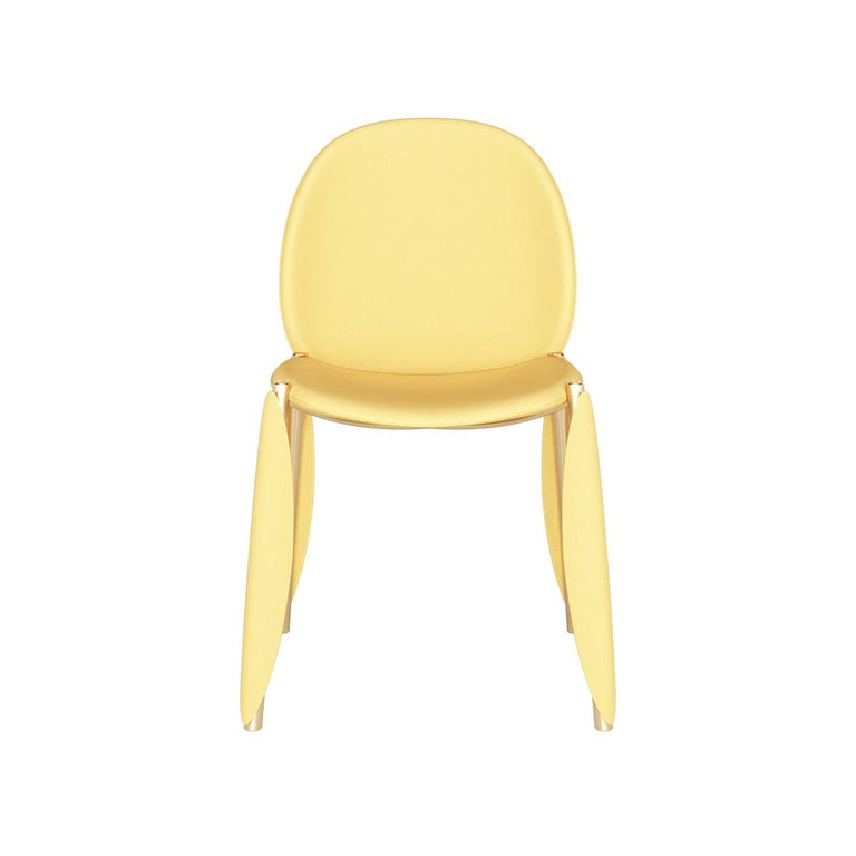 Contemporary Minimal yellow velvet dining chair in gold polished stainless steel mantis dining chair Mantis dining chair is a luxurious dining chair expressed by a combination of unique materials, which make it the perfect option for a modern