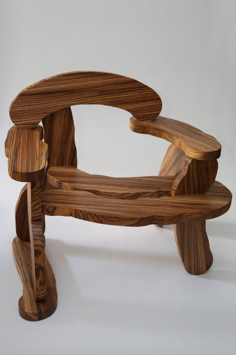 Unique handmade solid Zebrano wood armchair from the