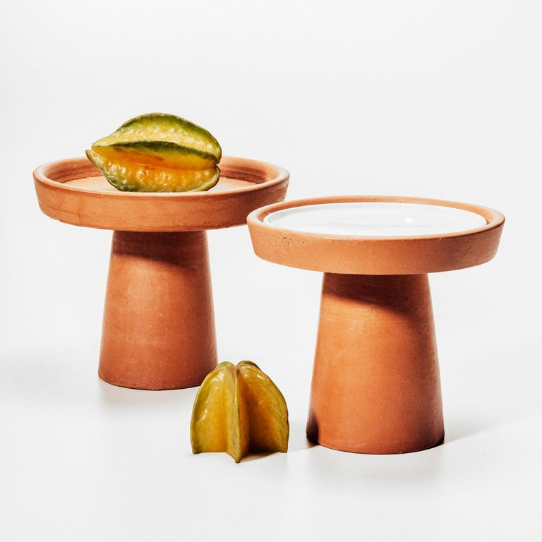 Designed by Brunno Jahara, contemporary Brazilian design, Clay, Brazil, 2014.  Set of trays with two different sizes, large and medium. The base rises and expands into a plate shape.   Measures: Large tray 1 level, H 10, 24 in. x Ø 7, 48 in., H