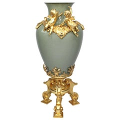 Continental 19th-20th Century Porcelain and Gilt Metal Mounted Vase with Cherubs