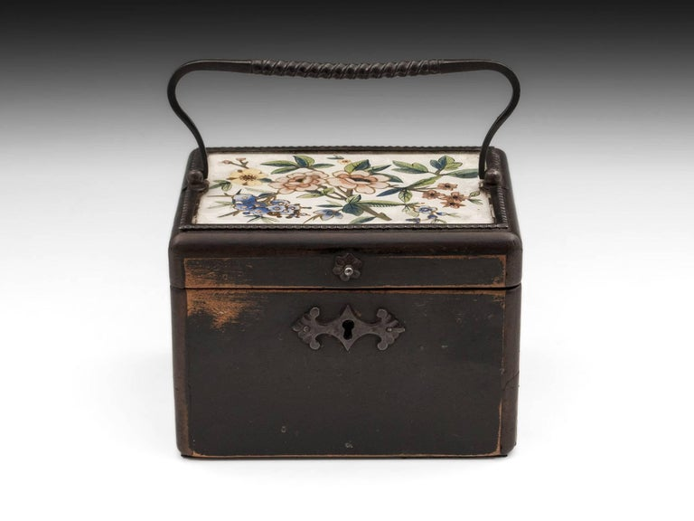 Sycamore tea caddy, floral painted with gold highlights under a glass top. With a cut steel handle, surround, escutcheon and finger pull. 