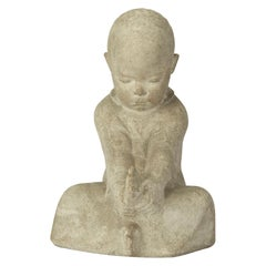 Continental Carved Stone Figure of a Seated Infant, 20th Century