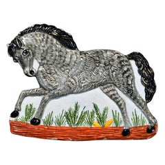 Continental Faience Plaque in the Form of a Horse, circa 1840
