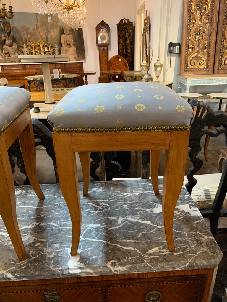 Lovely continental fruitwood Biedermeier style stools. Upholstered in a beautiful grey and gold fabric. Very nice accessory for an elegant home! Note: Price listed is per item.