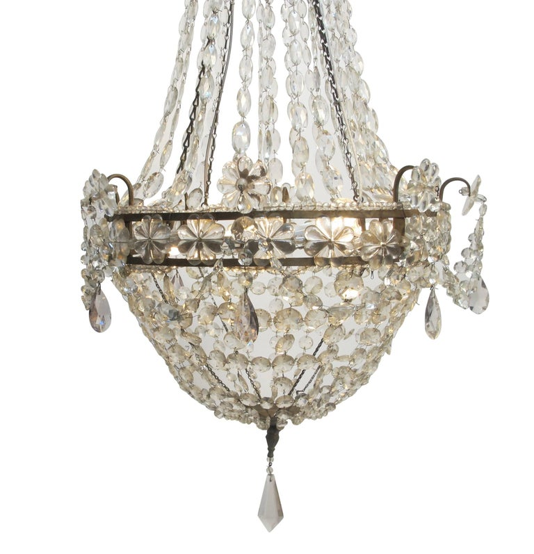 European Continental Gilt Iron and Faceted Crystal Chandelier For Sale