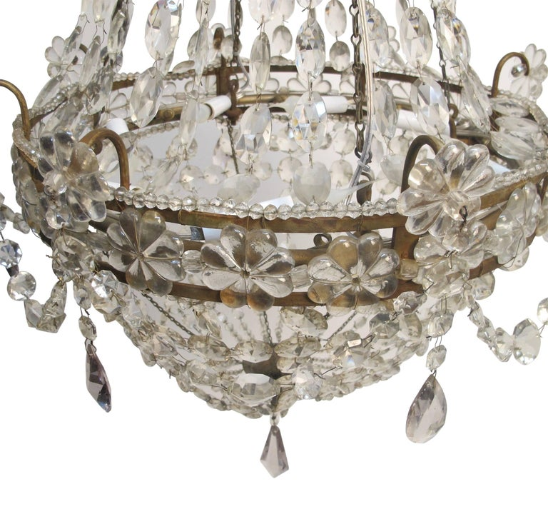 20th Century Continental Gilt Iron and Faceted Crystal Chandelier For Sale