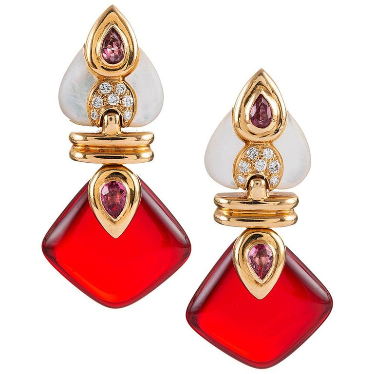 These earrings are highly reminiscent of Bulgari- or Marina B's iconic designs and are signed