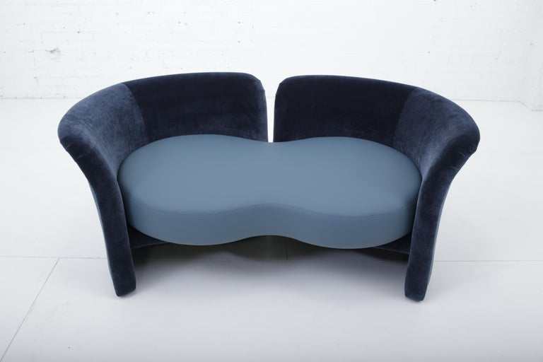 Convertible settee/tete-a-tete by Ransom Culler for Thayer-Coggin. One arm pivots to transform the shape of sofa. New leather and new velvet upholstery.