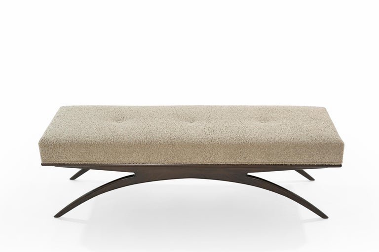 Artfully balanced. This handcrafted bench has a lightweight aesthetic with solid construction. The prim, rectangular cushion is beautifully upholstered in soft natural bouclé, resting delicately on a solid walnut base. Elevate your space with