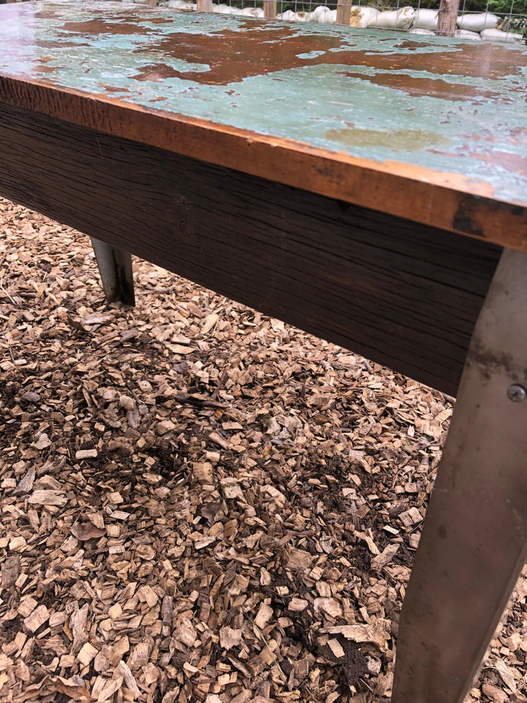 Cool Industrial Distressed Wood Table with Metal Legs For Sale 4