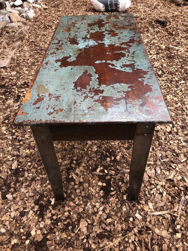 Cool Industrial Distressed Wood Table with Metal Legs For Sale 1