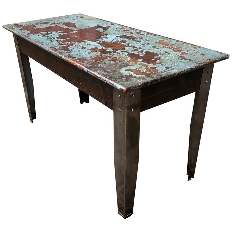 Cool Industrial Distressed Wood Table with Metal Legs For Sale
