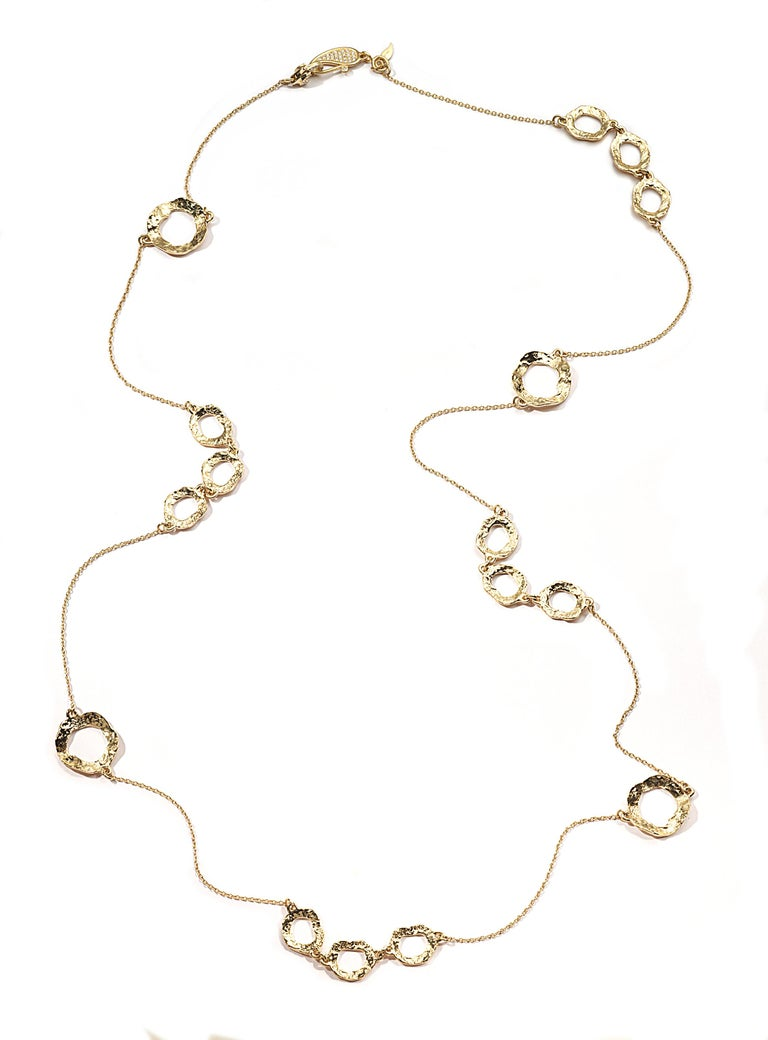 Hand made Coomi open flower necklace set in 20K yellow gold with 0.11cts pavé diamonds on clasp closure.