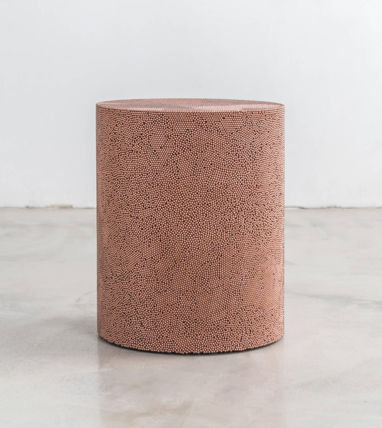 Composed from copper BB pellets, this made-to-order drum has a hollow cavity and consists fully of copper ammunition, creating a hypnotic camouflage of texture and smoothness. The piece has a hollow cavity and weighs approximately 90lbs.