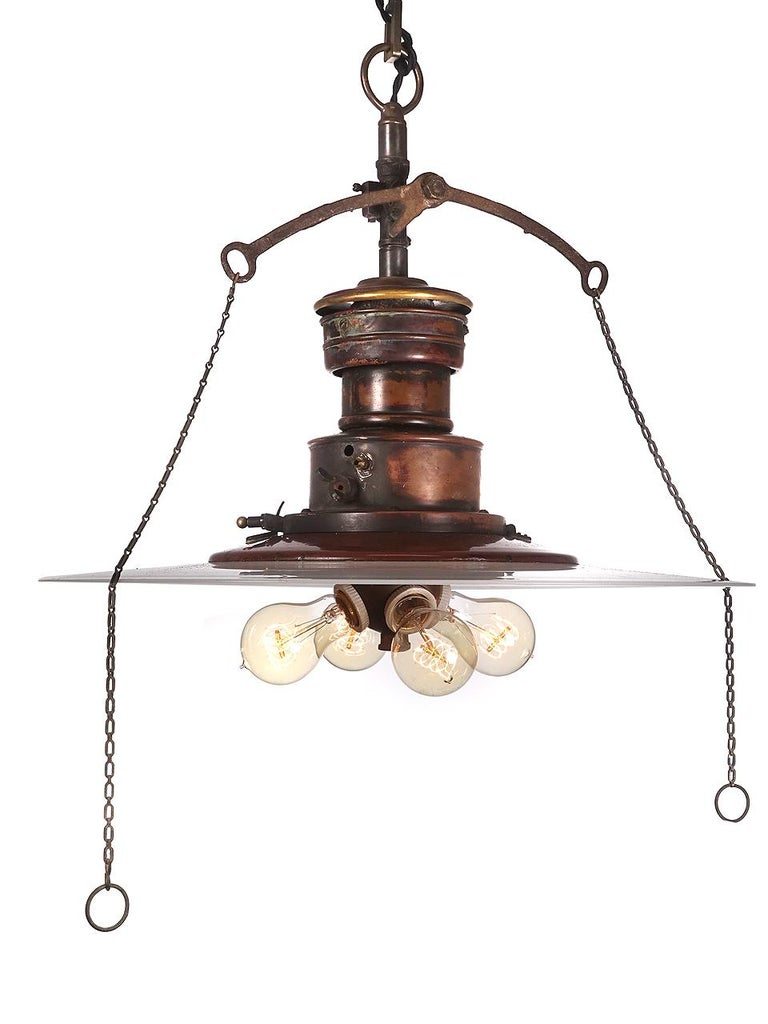 We love the look of this lamp. You just can't find hand blown 20 inch flat milk glass disk shades anymore. The shade featured on this lamp is very flat and that is desirable. It also has a rare 4 bulb Benjamin bulb cluster. The lamp is all copper