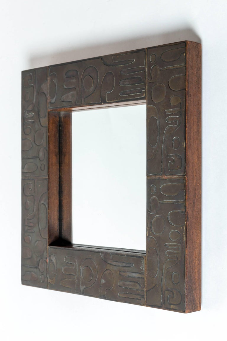 Copper mirror with graphic Inlay design, signed C. Perrat, France, 20th century.