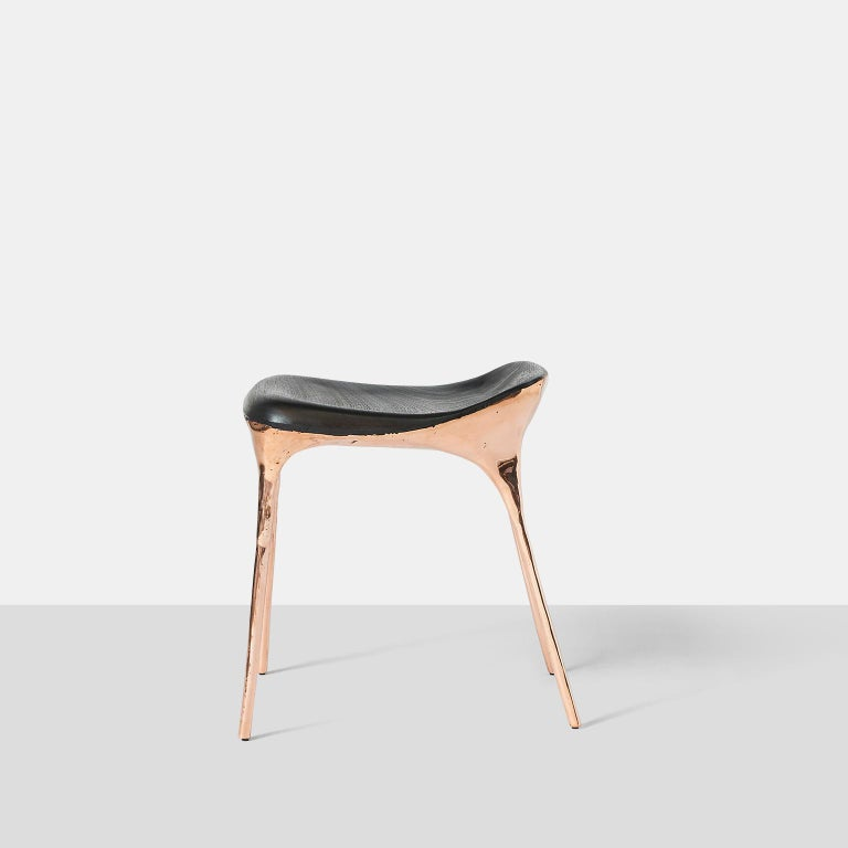 Copper stool with back by Valentin Loellmann A stool with a scooped back edge in solid copper with blackened oak seat.