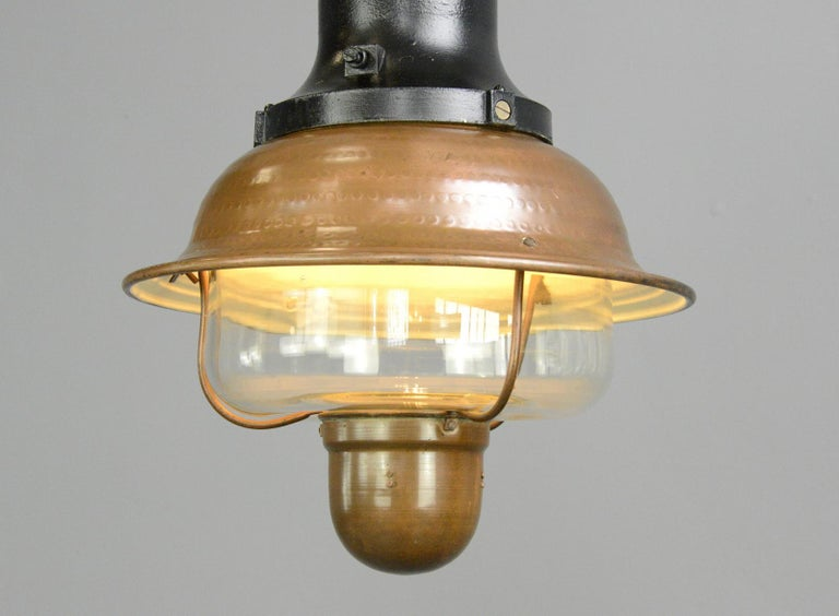 Copper train station light by Industria Rotterdam, circa 1920s  Glass diffuser - Hammered copper shade - Cast iron top - Takes E27 fitting bulbs - Comes with 100cm of cable and chain - Made by Industria Rotterdam - Dutch, 1930s - Measures: