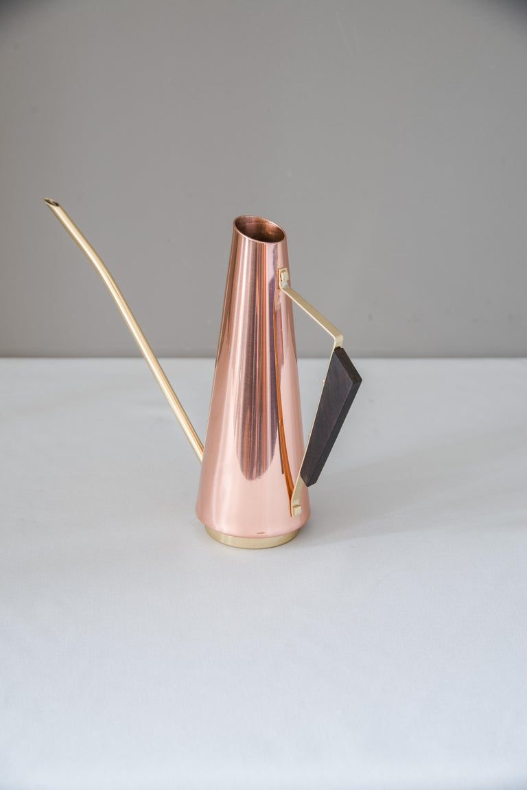 Copper watering can with wood handle and brass parts, circa 1960s
