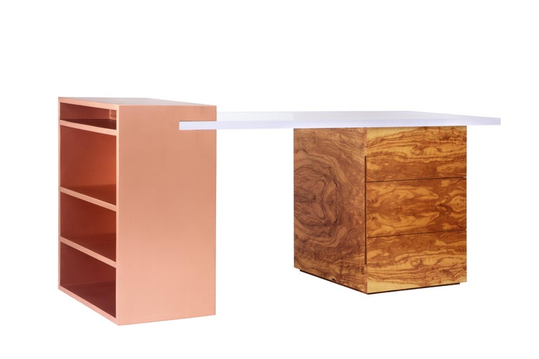 The coppertone desk defies the laws of perception with its distinctive and sophisticated design. The functionality of the piece is enhanced by the shelving unit in brushed copper which is emphasized by the unexpected acrylic top. The nobility of the