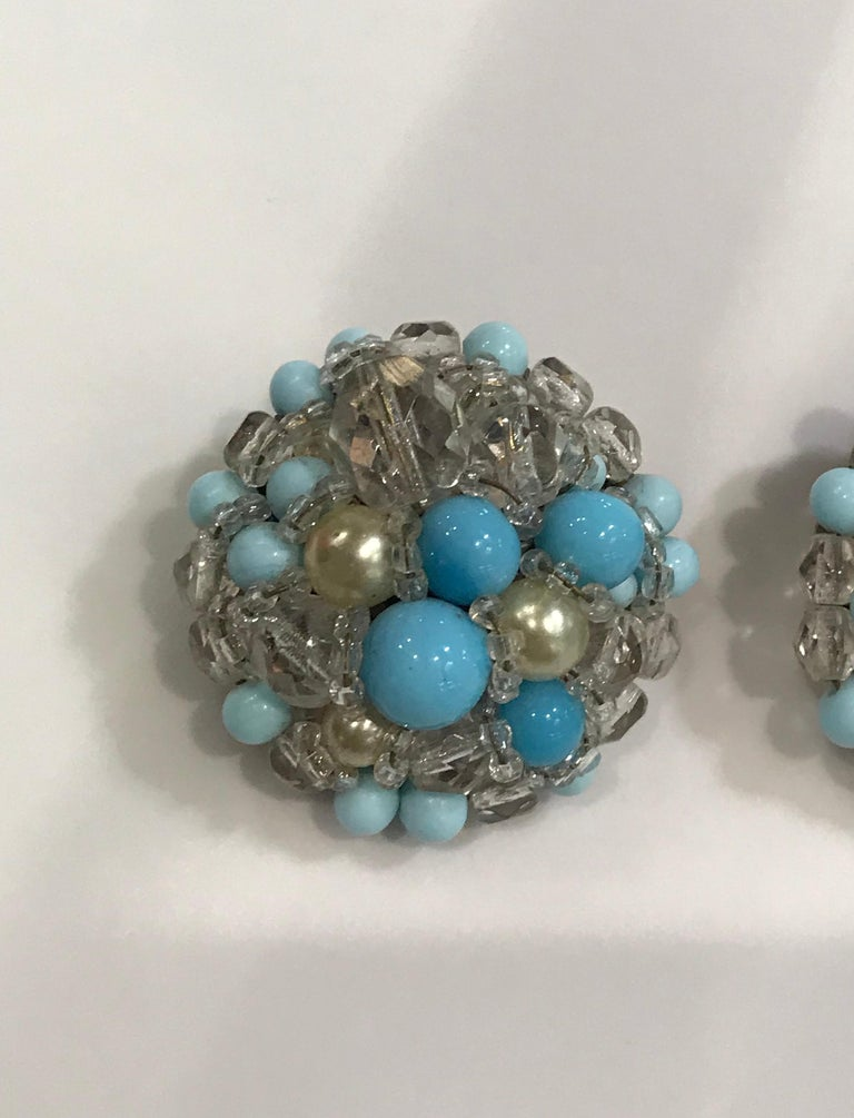A very nice pair of 1950s Coppola e Toppo faceted crystal bead, Murano glass and faux pearl bead button earrings. Hand made turquoise glass beads have lovely light and dark striations in the turquoise color. Clip backs have signature Coppola e Toppo