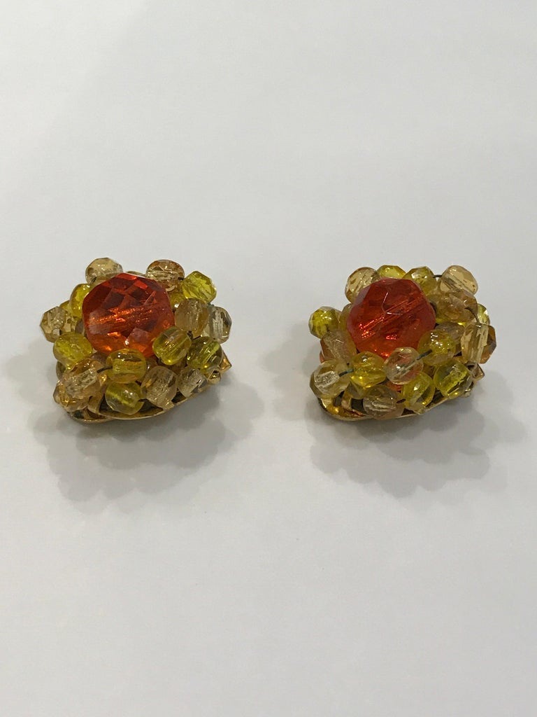 A very nice pair of petite 1950s Coppola e Toppo faceted yellow, gold and orange crystal bead earrings. Center large bead in orange crystal. Surrounding smaller beads alternate in pale gold and yellow frystal. Clip backs have signature Coppola e