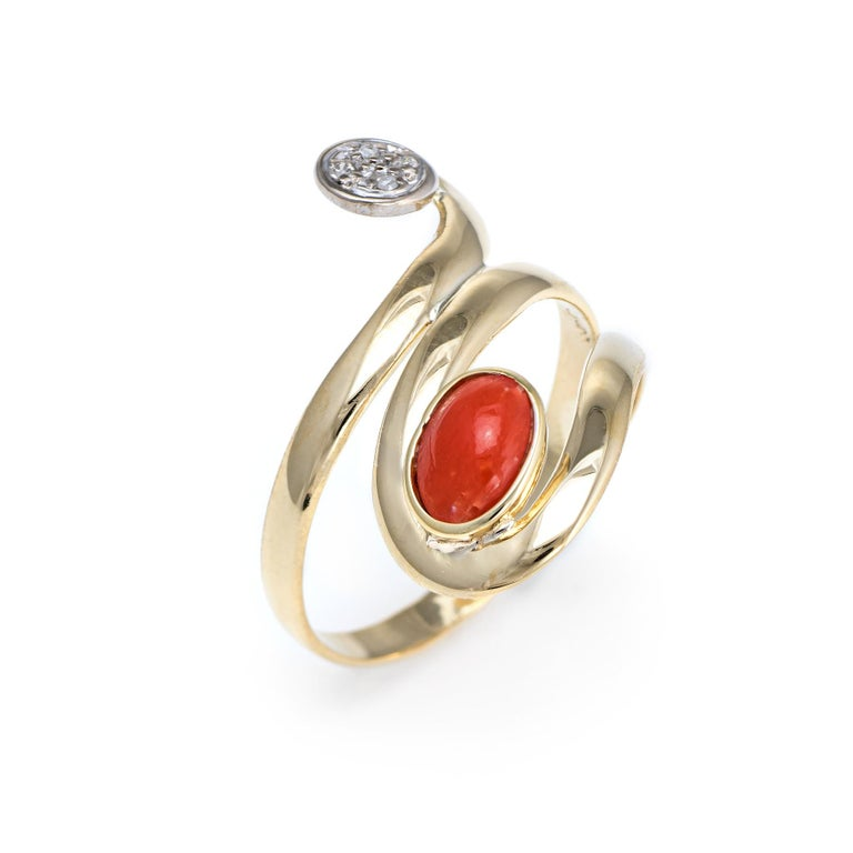 Elegant vintage coral & diamond ring (circa 1960s to 1970s), crafted in 18 karat yellow gold.   Cabochon cut salmon coral measures 6mm x 4mm (estimated at 0.40 carats). The diamonds total an estimated 0.02 carats (estimated at H-I color and SI2-I1
