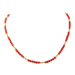 Coral Sphere and 18 Karat Yellow Gold Beaded Necklace