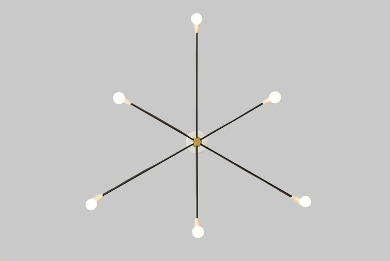 The Cord Family is a celebration of form driven by physics. The series began as an exercise to simplify Jean Prouvé's classic Potence lamp by using the fixture's electrical cord in place of the guy wire. The result is a pleasing symmetry between the